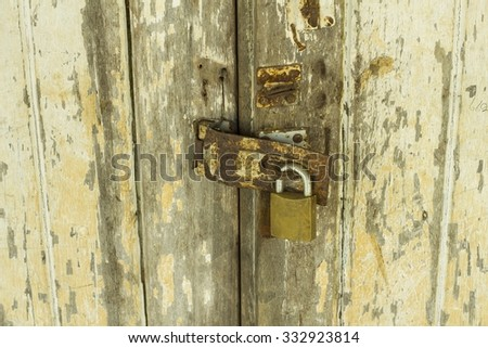 Old lock on the door - lock on the door of an old house - stock photo