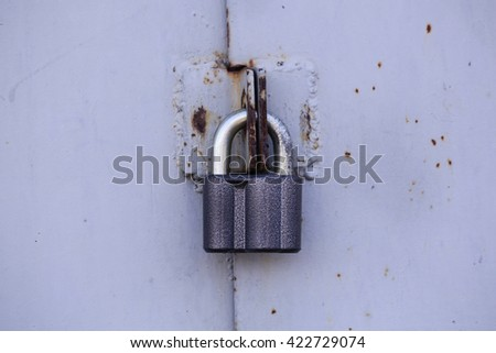 Old lock on the metal door - stock photo