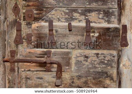 Old lock with rust, keyhole and padlock