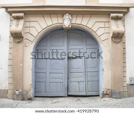 Old locked wooden gate. - stock photo