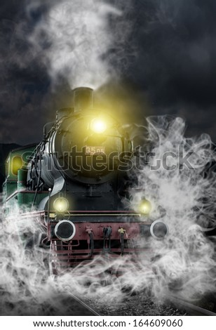 old locomotive at night - stock photo