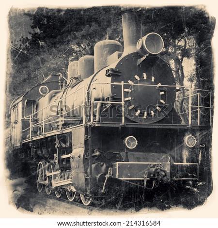 Old locomotive in retro black and white design, vintage stylized - stock photo