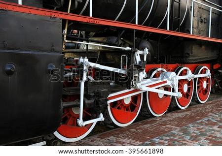 Old Locomotive Wheels - stock photo