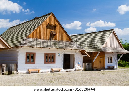 Old log cabin in an open-air ethnography museum in Sanok, Poland. Heritage park is located next to the forest and immitates typical Polish village from past centuries.