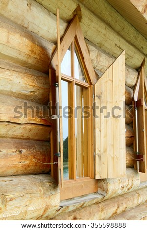 Old log chapel with an open window - stock photo