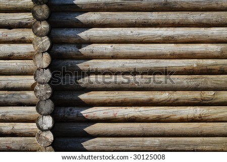 Old log wall of rural building - stock photo