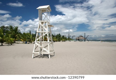 Old lonely wooden lifeguard tower on a beach in Tela. Honduras