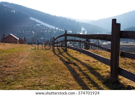 Old long wooden fence  - stock photo