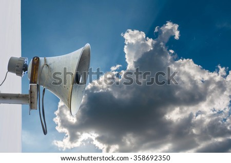 Old loudspeaker and blue sky