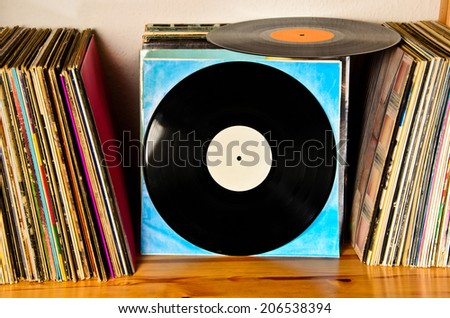 old lps on the shelf to be played back - stock photo