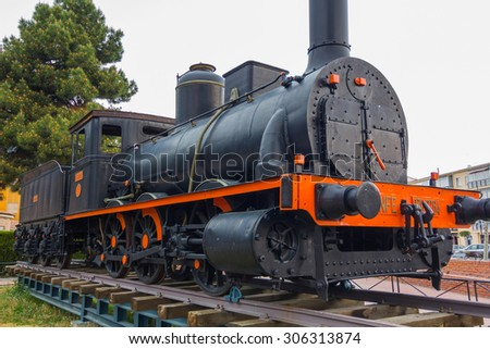 old machine train (1863) Carbon black and red - stock photo