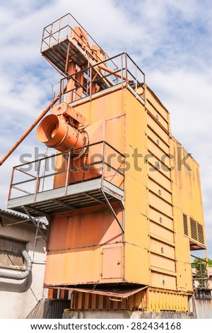 Old machinery for silos agricultural  obsolete and abandoned - stock photo
