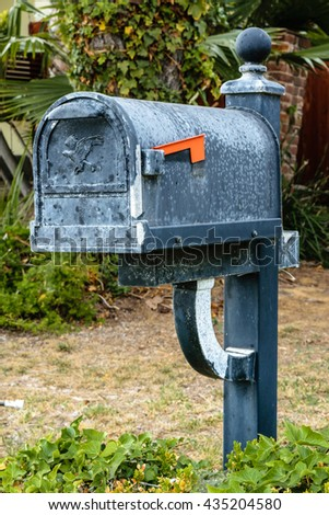 old mail box on stand pole
