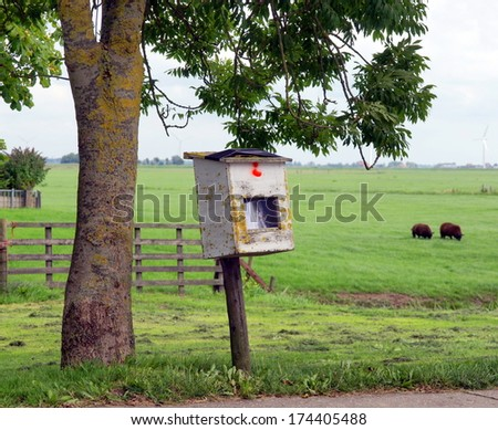 old mail box on the countryside standing next to the road  - stock photo