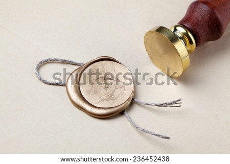 old mail envelope with gold wax seal stamps - stock photo
