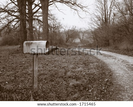 Old mailbox by the lane. - stock photo