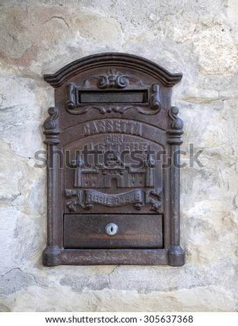 old mailbox iron ,old mailbox Italian on the wall of a house, photo front, natural light - stock photo