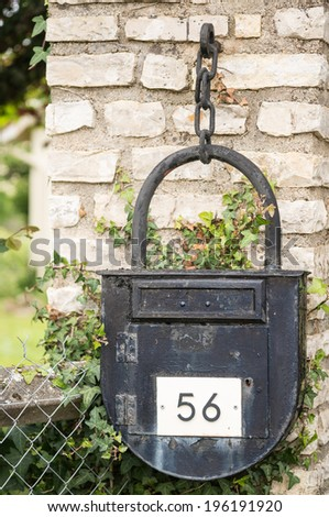 Old mailbox with the shape of a lock - stock photo