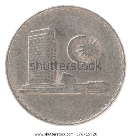 Old Malaysian coin with the image of the government building isolated on white background