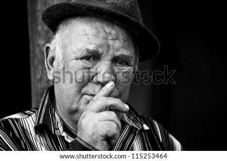 old man asks you to keep silent - stock photo