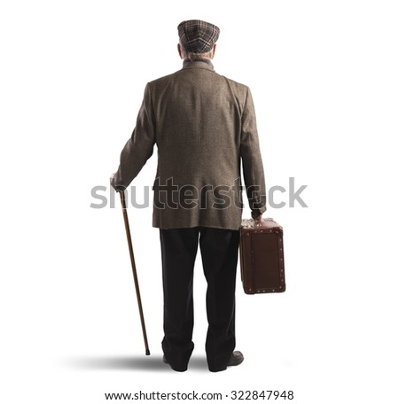 Old man back with suitcase and stick - stock photo