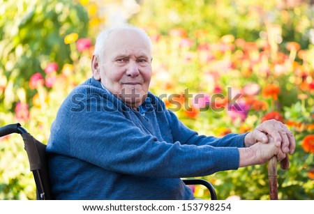Old man being lonely in the garden. - stock photo