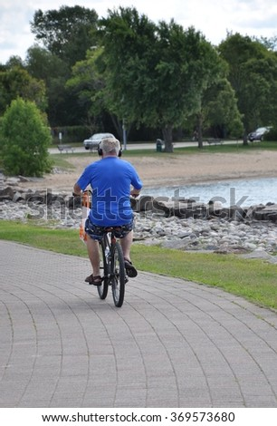 Old man biking - stock photo