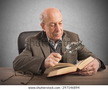 Old man deepens his knowledge and culture - stock photo