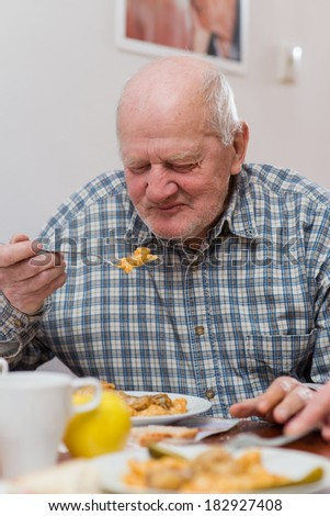 Old man eating a healthy meal