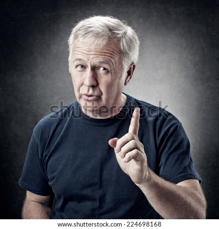 Old man emphasizing an idea for someone - stock photo