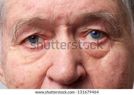 old man face part closeup eyes looks at camera - stock photo