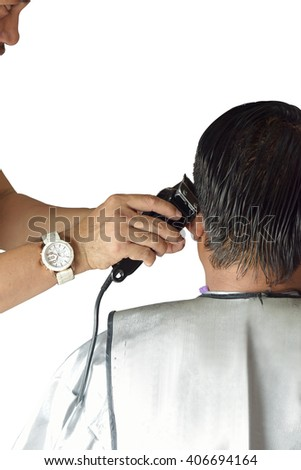 Old man getting his head shaved by barber isolated on white background. This Has clipping path.