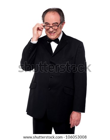 Old man holding his eyeglasses and smiling at camera. Fashion portrait - stock photo
