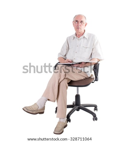 Old man in glasses with folder and pen sitting on a chair. Isolated on a white background.