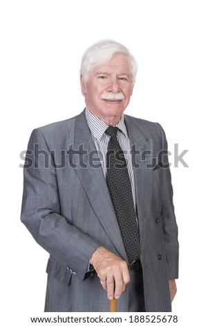 Old man in grey suit and walking stick in studio on a white background - stock photo