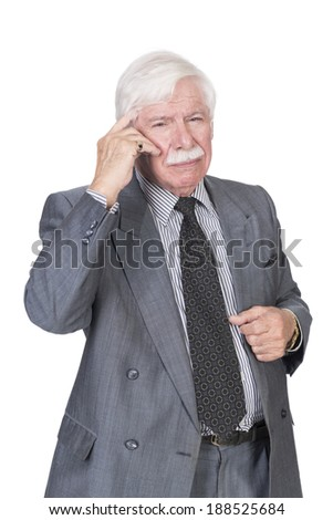 Old man in suit and gray hair thinking - stock photo