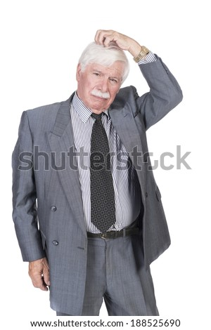 Old man in suit and gray hair thinking and scratching his head - stock photo