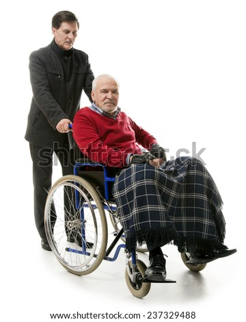 old man in wheelchair with younger man
