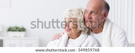 Old man is hugging his beautiful wife