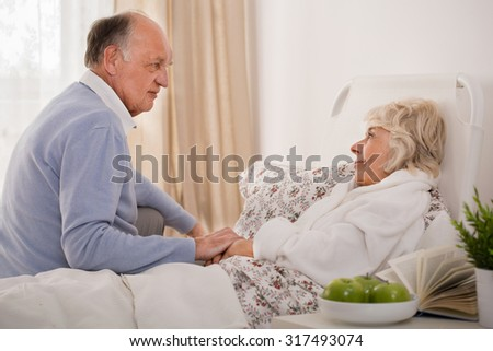 Old man is taking care of his elder wife