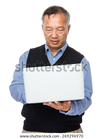 Old man learn to use laptop computer - stock photo