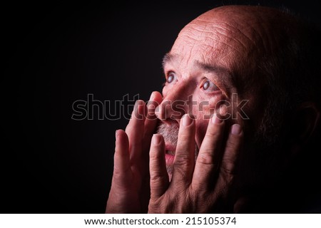 old man looking frighten or scared - stock photo