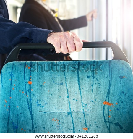 old Man on a bus travelling waiting the stop - stock photo