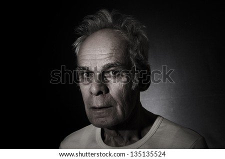 Old man on black background