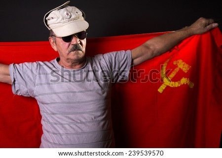 old man patriot with flag of the USSR - stock photo
