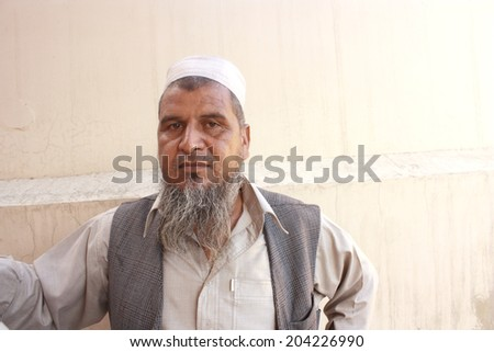 Old man posing for photographer - stock photo