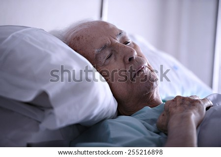 Old man sleeping in a hospital - stock photo