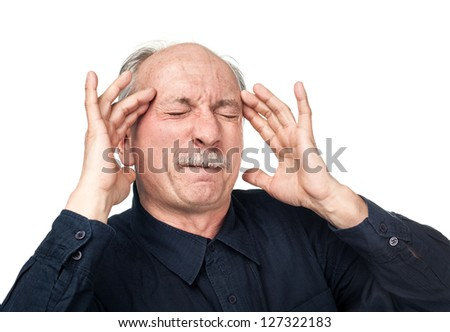 Old man suffering from a headache isolated on white