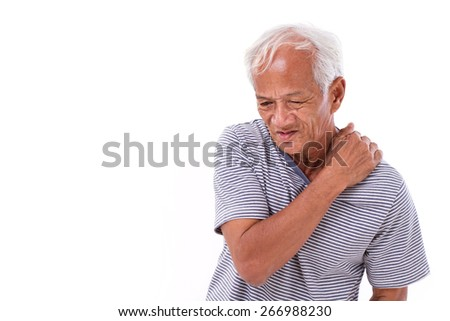 old man suffering from shoulder muscle inflammation or injury - stock photo