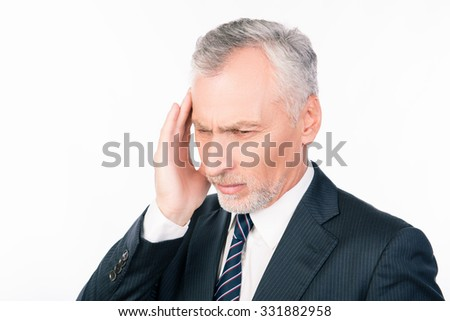 Old man suffering of headache in business suit - stock photo
